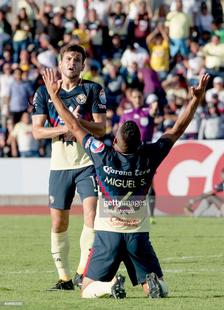 Miguel Angel Samudio of America celebrates the third goal of his team scored by Oribe Peralta (Not in Frame) during the fifth round match between Lobos BUAP and America as part of the Torneo Apertura 2017 Liga MX at Olimpico de la BUAP Stadium on August 19, 2017 in Puebla, Mexico.