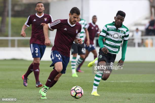 Miguel Angelo of CD Cova da Piedade with Gelson Dala of Sporting CP B in action during the Segunda Liga match between CD Cova da Piedade and Sporting...