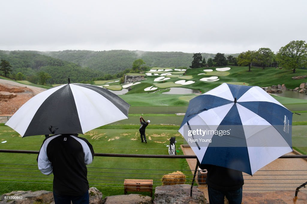 Miguel Angle Jimenez practices on the range as fans watch during the first round, which was suspended due to weather, of the PGA TOUR Champions Bass Pro Shops Legends of Golf at Big Cedar Lodge at Top of the Rock on April 21, 2017 in Ridgedale, Missouri.