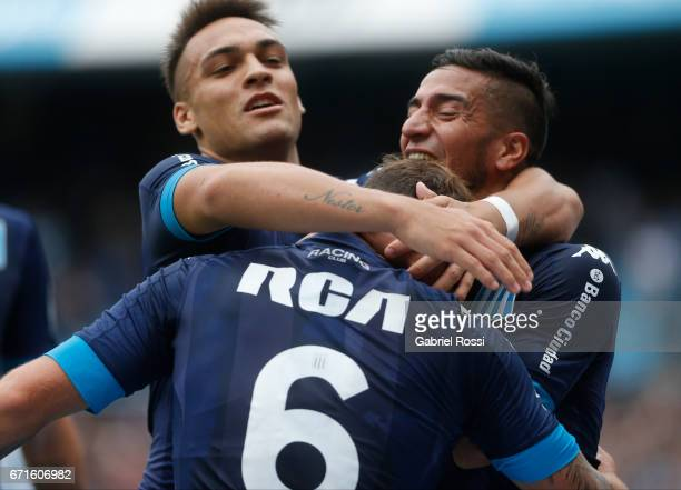 Miguel Barbieri of Racing Club celebrates with Diego Gonzalez and Lautaro Martinez after scoring the second goal of his team during a match between...