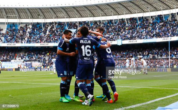 Miguel Barbieri of Racing Club celebrates with teammates after scoring the second goal of his team during a match between Racing and Atletico de...