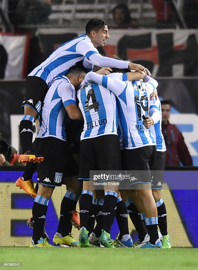Miguel Barbieri of Racing Club celebrates with teammates Diego Gonzalez, Sergio Vittor and Ivan Pillud after scoring the second goal of his team during a match between River Plate and Racing Club as part of Torneo Primera Division 2016/17 at Monumental Stadium on June 18, 2017 in Buenos Aires, Argentina.