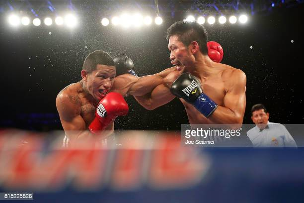 Miguel Berchelt and Takashi Miura throw punches int he sixth round of the WBC Super Featherweight Title Fight at The Forum on July 15 2017 in...