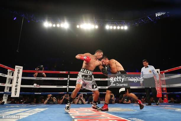 Miguel Berchelt throws a punch in the tenth round of the WBC Super Featherweight Title Fight against Takashi Miura at The Forum on July 15 2017 in...