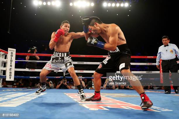Miguel Berchelt throws a punch to Takashi Miura in the first round of the WBC Super Featherweight Title Fight at The Forum on July 15 2017 in...