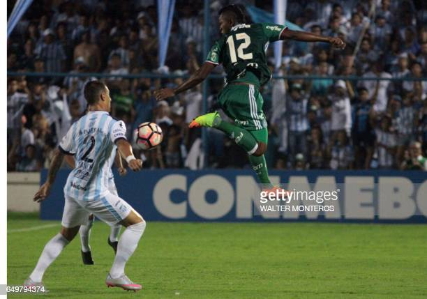 Miguel Borja Hernandez of Brazil's Palmeiras vies for the ball with Bruno Bianchi of Argentina's Atletico Tucuman in their Copa Libertadores football...