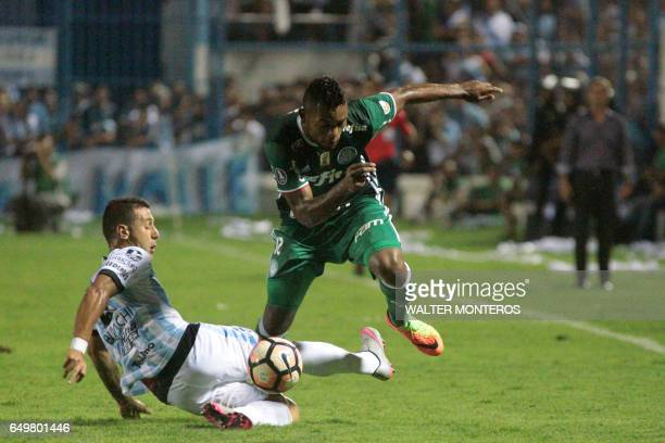 Miguel Borja Hernandez of Brazil's Palmeiras vies for the ball with Bruno Bianchi of Atletico Tucuman in their Copa Libertadores football match in...