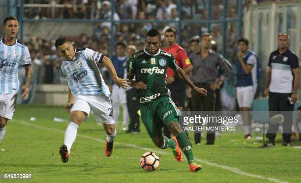 Miguel Borja Hernandez of Brazil's Palmeiras vies for the ball with Leonel Di Placido of Argentina's Atletico Tucuman during their Copa Libertadores...