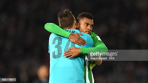 Miguel Borja of Atletico Nacional celebrates with Franco Armani of Atletico Nacional following victory in the penalty shoot out during the FIFA Club...