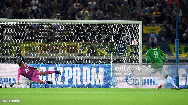 Miguel Borja of Atletico Nacional scores the winning penalty during the FIFA Club World Cup 3rd Place match between Club America and Atletico...