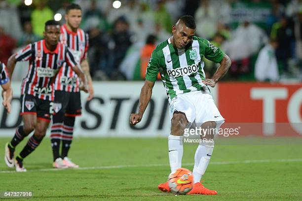 Miguel Borja of Atletico Nacional takes a penalty to score the second goal of his team during a second leg semi final match between Atletico Nacional...