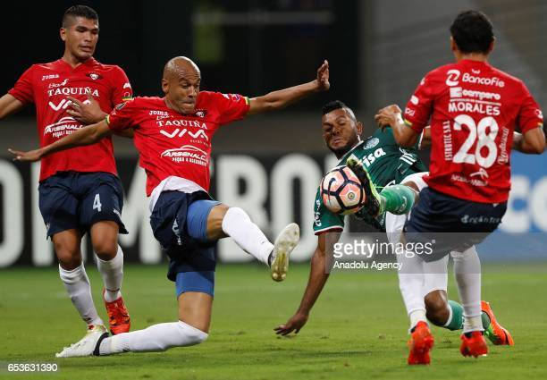 Miguel Borja of Brazil's Palmeiras in action next to Alex Silva of Bolivia's Jorge Wilstermann during their Libertadores Cup football match held at...