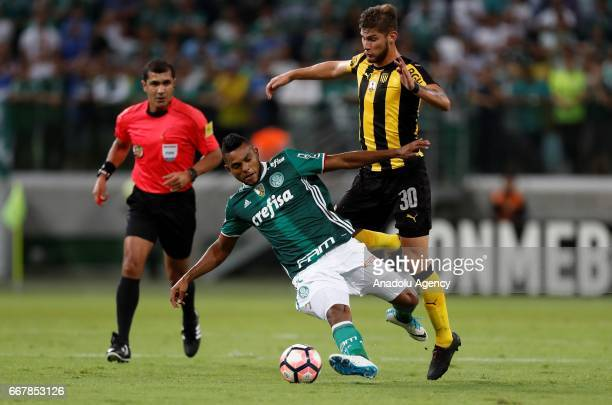 Miguel Borja of Brazil's Palmeiras tries to control the ball next to Agustin Quintana of Uruguay's Penarol during Libertadores Cup match between...