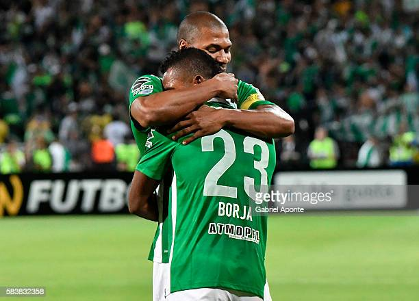 Miguel Borja of Nacional celebrates with teammate Alexis Henriquez after scoring the opening goal during a second leg final match between Atletico...