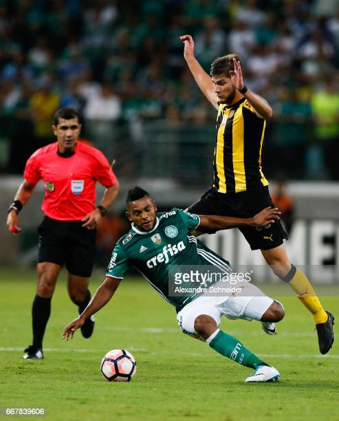 Miguel Borja of Palmeiras and Augustin Quintana of Penarol in action during the match between Palmeiras of Brazil and Penarol of Uruguay for the Copa...