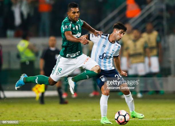Miguel Borja of Palmeiras of Brazil and Leonel di Placido of Atletico Tucuman of Argentina in action during the match between Palmeiras and Atletico...
