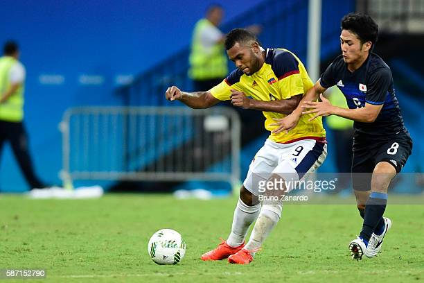 Miguel Borja player of Colombia battles for the ball with Ryota Oshima player of Japan during 2016 Summer Olympics match between Japan and Colombia...