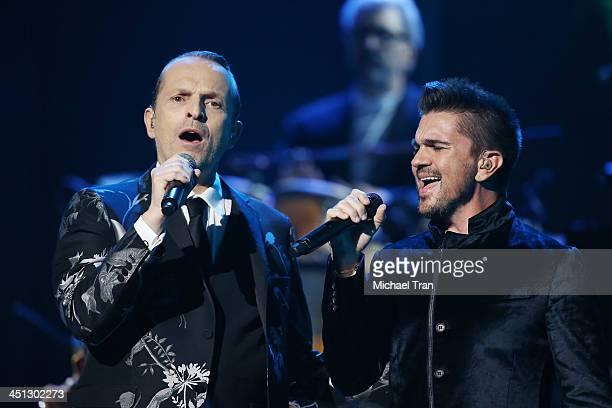 Miguel Bose and Juanes perform onstage during the 14th Annual Latin GRAMMY Awards held at Mandalay Bay Resort and Casino on November 21 2013 in Las...