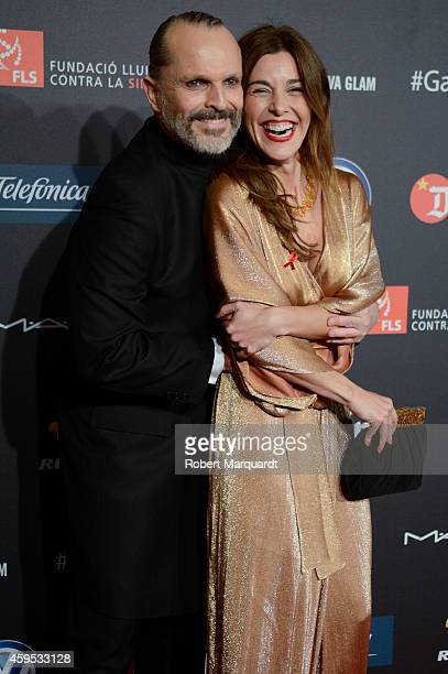 Miguel Bose and Raquel Sanchez Silva pose during a photocall for 'Gala Against HIV 2014' at the Museu Nacional d'Art de Catalunya on November 24 2014...