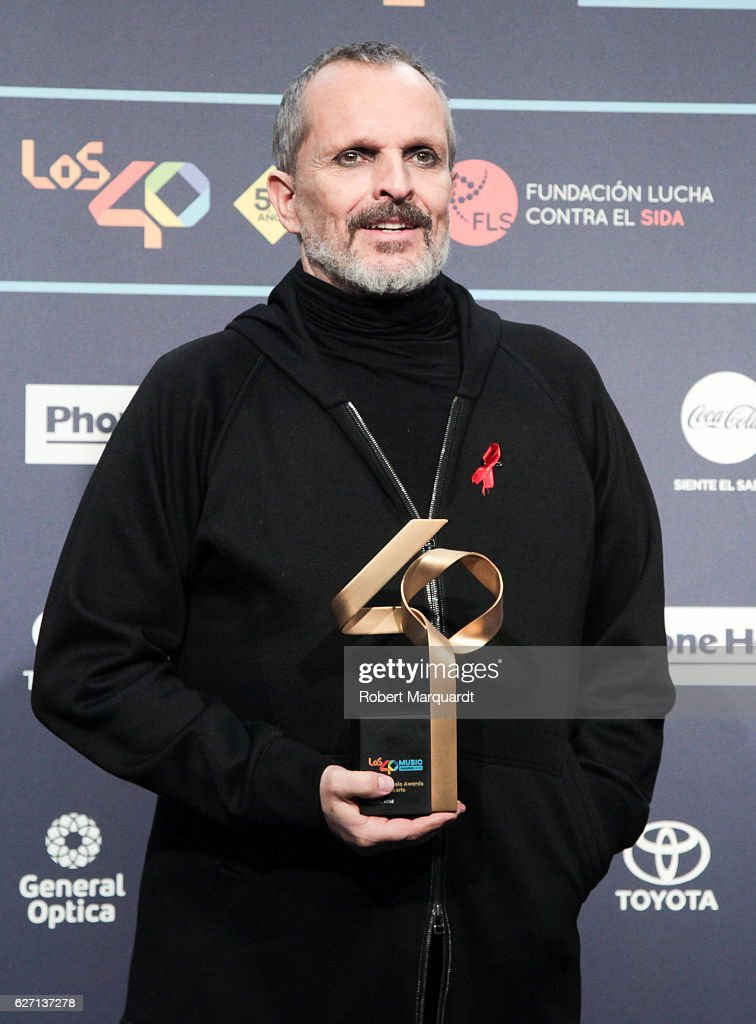 miguel-bose-poses-backstage-after-receiving-an-award-from-the-los-40-picture-id627137278