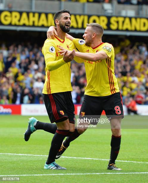 Miguel Britos of Watford celebrates scoring their third goal with Tom Cleverley of Watford during the Premier League match between Watford and...