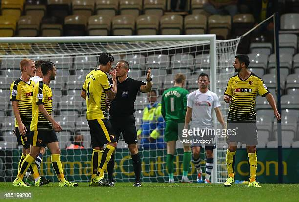 Miguel Britos of Watford is sent off by referee Steve Martin during the Capital One Cup Second Round match between Preston North End and Watford at...
