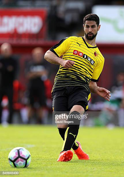 Miguel Britos of Watford passes the ball during the pre season friendly match between Woking and Watford at The Laithwaite Community Stadium on July...