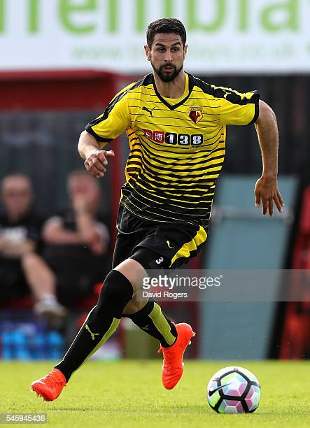 Miguel Britos of Watford runs with the ball during the pre season friendly match between Woking and Watford at The Laithwaite Community Stadium on...