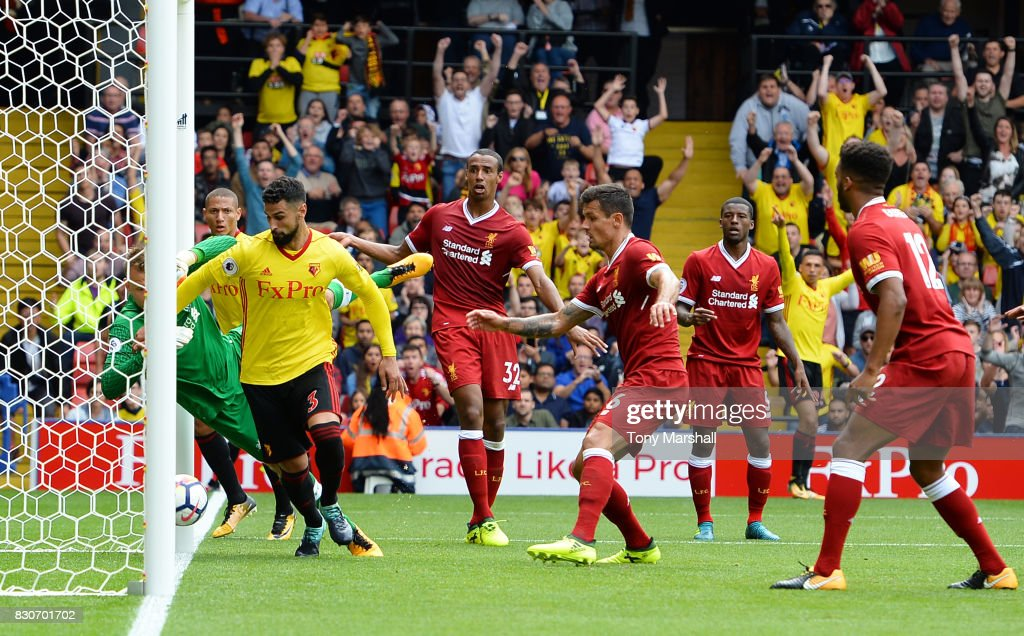 Miguel Britos of Watford scores his sides third goal during the Premier League match between Watford and Liverpool at Vicarage Road on August 12, 2017 in Watford, England.