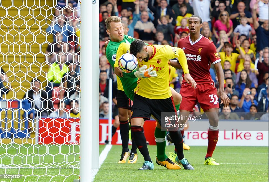 Miguel Britos of Watford scores his sides third goal past Simon Mignolet of Liverpool during the Premier League match between Watford and Liverpool at Vicarage Road on August 12, 2017 in Watford, England.