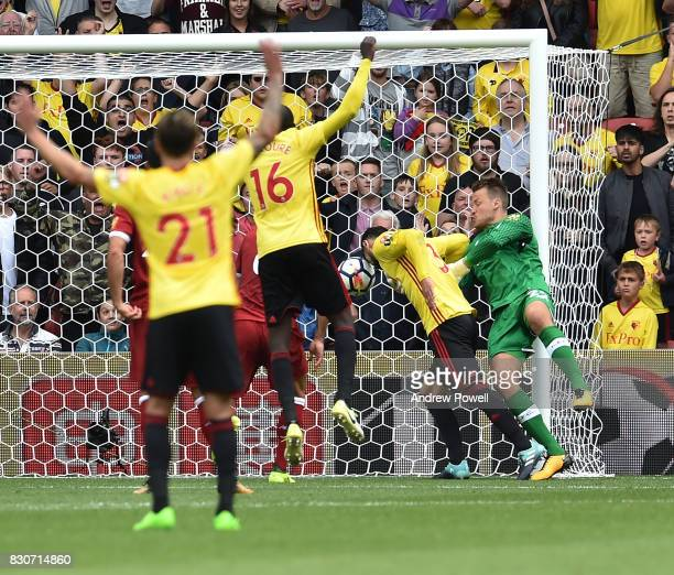 Miguel Britos of Watford scores the third during the Premier League match between Watford and Liverpool at Vicarage Road on August 12 2017 in Watford...