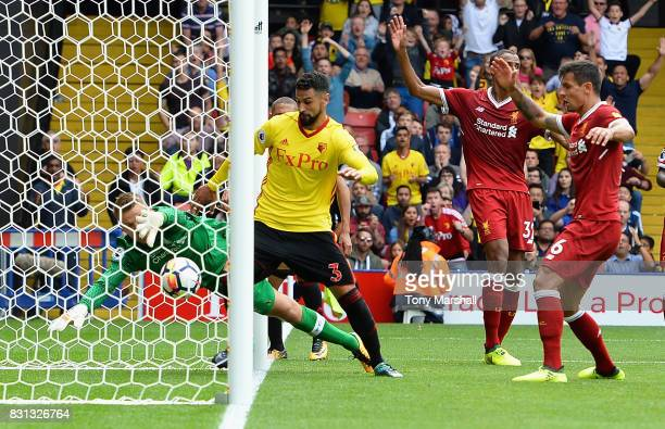 Miguel Britos of Watford scores their third goal during the Premier League match between Watford and Liverpool at Vicarage Road on August 12 2017 in...