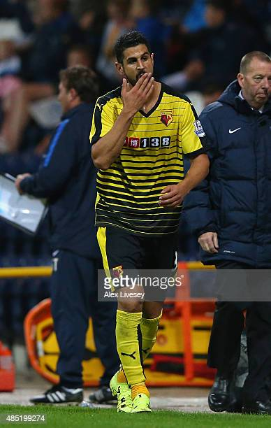 Miguel Britos of Watford walks off the pitch after being sent off by referee Steve Martin during the Capital One Cup Second Round match between...