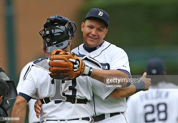 Miguel Cabrera and Alex Avila of the Detroit Tigers celebrate a win over the Kansas City Royals at Comerica Park on September 15 2013 in Detroit...