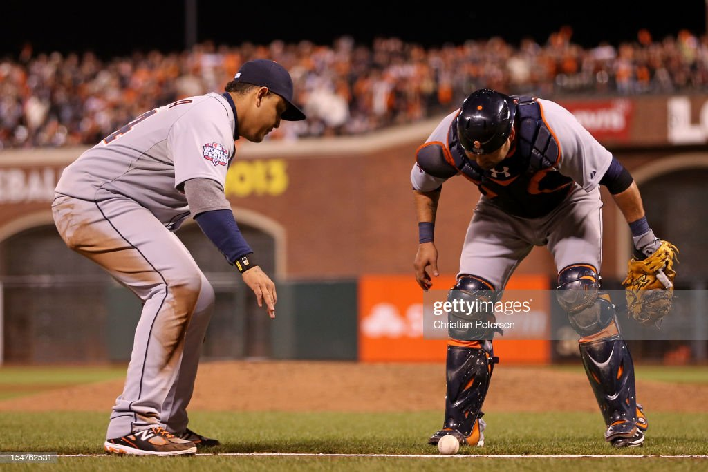 <a gi-track='captionPersonalityLinkClicked' href=/galleries/search?phrase=Miguel+Cabrera&family=editorial&specificpeople=202141 ng-click='$event.stopPropagation()'>Miguel Cabrera</a> #24 and <a gi-track='captionPersonalityLinkClicked' href=/galleries/search?phrase=Gerald+Laird&family=editorial&specificpeople=228949 ng-click='$event.stopPropagation()'>Gerald Laird</a> #9 of the Detroit Tigers wait to see if the ball goes foul on a bunt single by Gregor Blanco #7 of the San Francisco Giants in the seventh inning during Game Two of the Major League Baseball World Series at AT&T Park on October 25, 2012 in San Francisco, California.