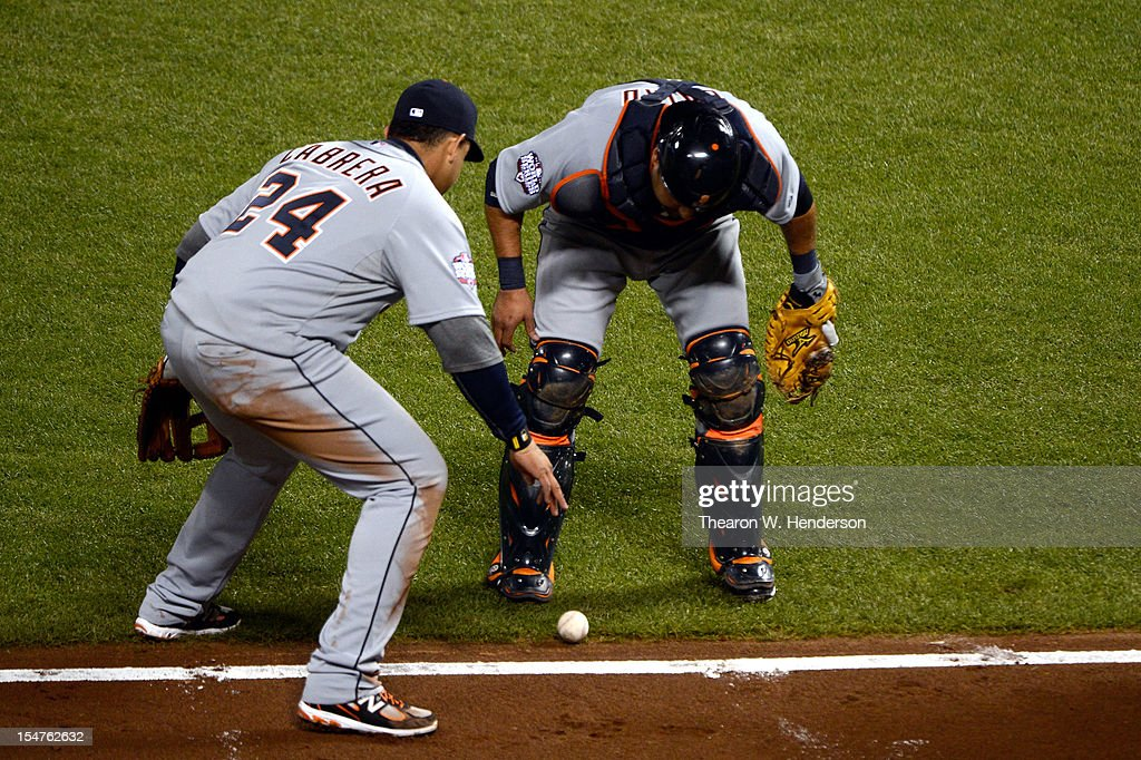 Miguel Cabrera #24 and Gerald Laird #9 of the Detroit Tigers wait to see if the ball goes foul on a bunt single by Gregor Blanco #7 of the San Francisco Giants in the seventh inning during Game Two of the Major League Baseball World Series at AT&T Park on October 25, 2012 in San Francisco, California.
