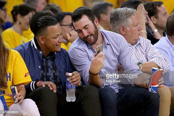 Miguel Cabrera and Justin Verlander of the Detroit Tigers look at the iPhone of Verlander during game five of the Western Conference Finals of the...