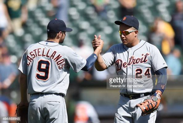 Miguel Cabrera and Nick Castellanos of the Detroit Tigers celebrate defeating the Oakland Athletics 54 at Oco Coliseum on May 29 2014 in Oakland...