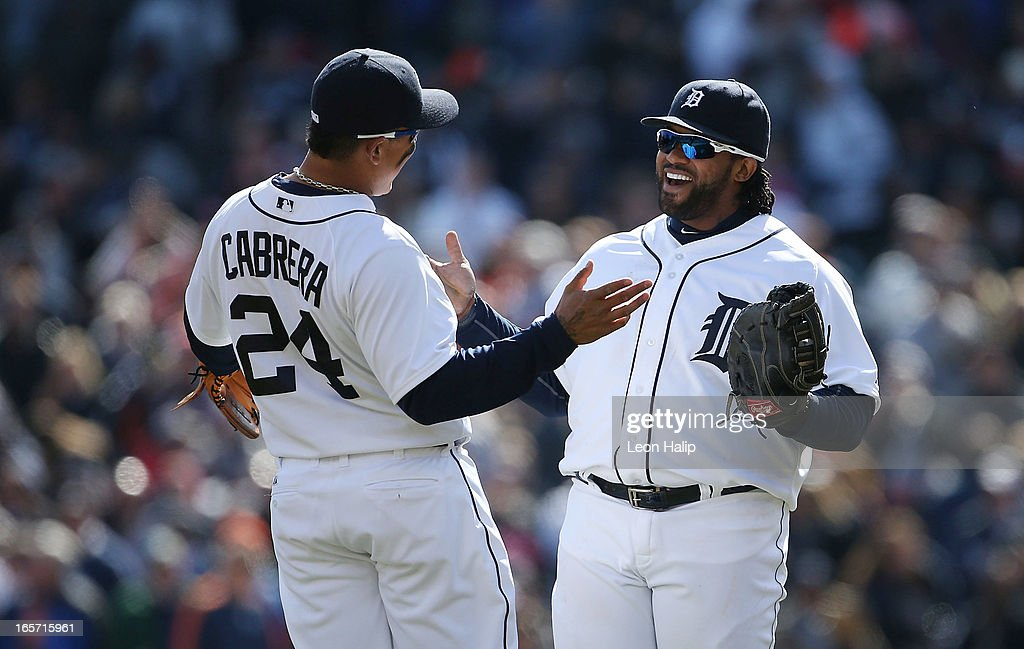 Miguel Cabrera #24 and Prince Fielder #28 of the Detroit Tigers celebrate a win over the New York Yankees in the home opener at Comerica Park on April 5, 2013 in Detroit, Michigan. The Tigers defeated the Yankees 8-3.