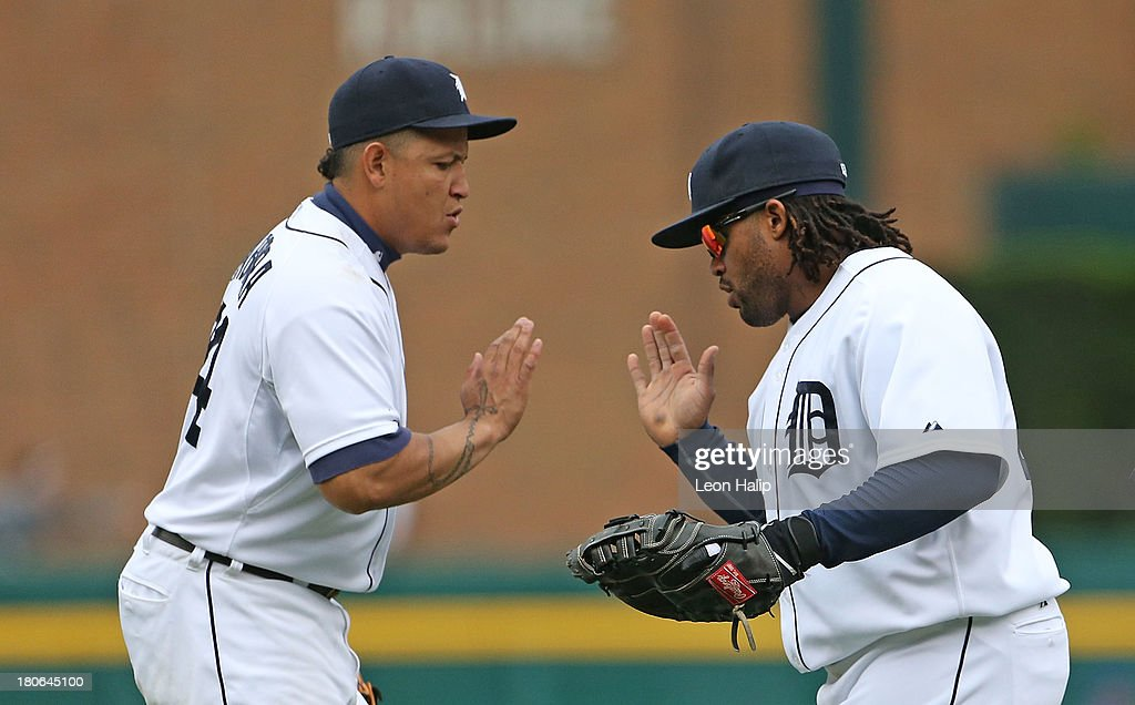 <a gi-track='captionPersonalityLinkClicked' href=/galleries/search?phrase=Miguel+Cabrera&family=editorial&specificpeople=202141 ng-click='$event.stopPropagation()'>Miguel Cabrera</a> #24 and Prince FIelder #28 of the Detroit Tigers celebrate a win over the Kansas City Royals at Comerica Park on September 15, 2013 in Detroit, Michigan. The Tigers defeated the Royals 3-2.