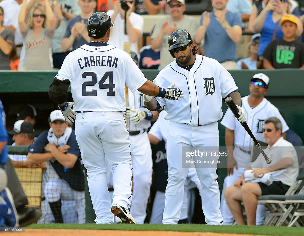 <a gi-track='captionPersonalityLinkClicked' href=/galleries/search?phrase=Miguel+Cabrera&family=editorial&specificpeople=202141 ng-click='$event.stopPropagation()'>Miguel Cabrera</a> #24 and <a gi-track='captionPersonalityLinkClicked' href=/galleries/search?phrase=Prince+Fielder&family=editorial&specificpeople=209392 ng-click='$event.stopPropagation()'>Prince Fielder</a> #28 of the Detroit Tigers shake hands after Cabrera hit a home run in the third inning of the spring training game against the Toronto Blue Jays at Joker Marchant Stadium on February 23, 2013 in Lakeland, Florida. The Blue Jays defeated the Tigers 10-3.