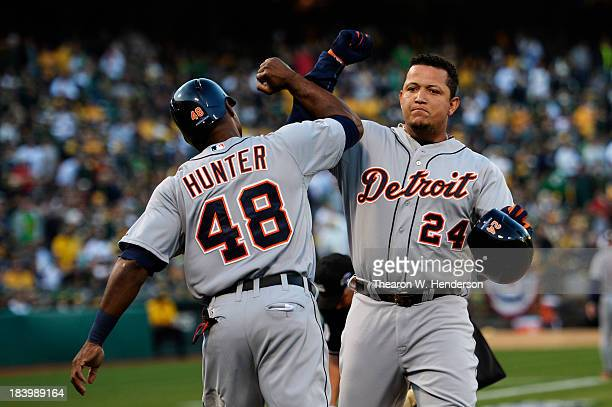 Miguel Cabrera celebrates his tworun home run scoring Torii Hunter of the Detroit Tigers in the fourth inning against the Oakland Athletics during...