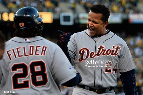 Miguel Cabrera celebrates his tworun home run with Prince Fielder of the Detroit Tigers in the fourth inning against the Oakland Athletics during...