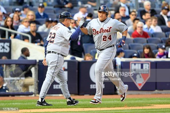Miguel Cabrera is congratulated by third base coach Gene Lamont of the Detroit Tigers after hitting a tworun home run in the first inning of Game Two...