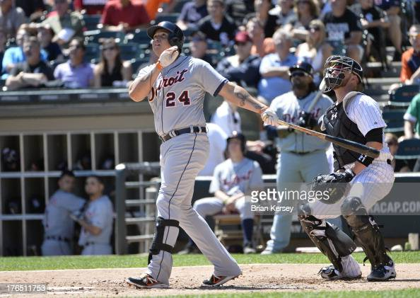 Miguel Cabrera of the Detroit Tigers and catcher Tyler Flowers of the Chicago White Sox watch Cabrera's threerun home run scoring Austin Jackson and...