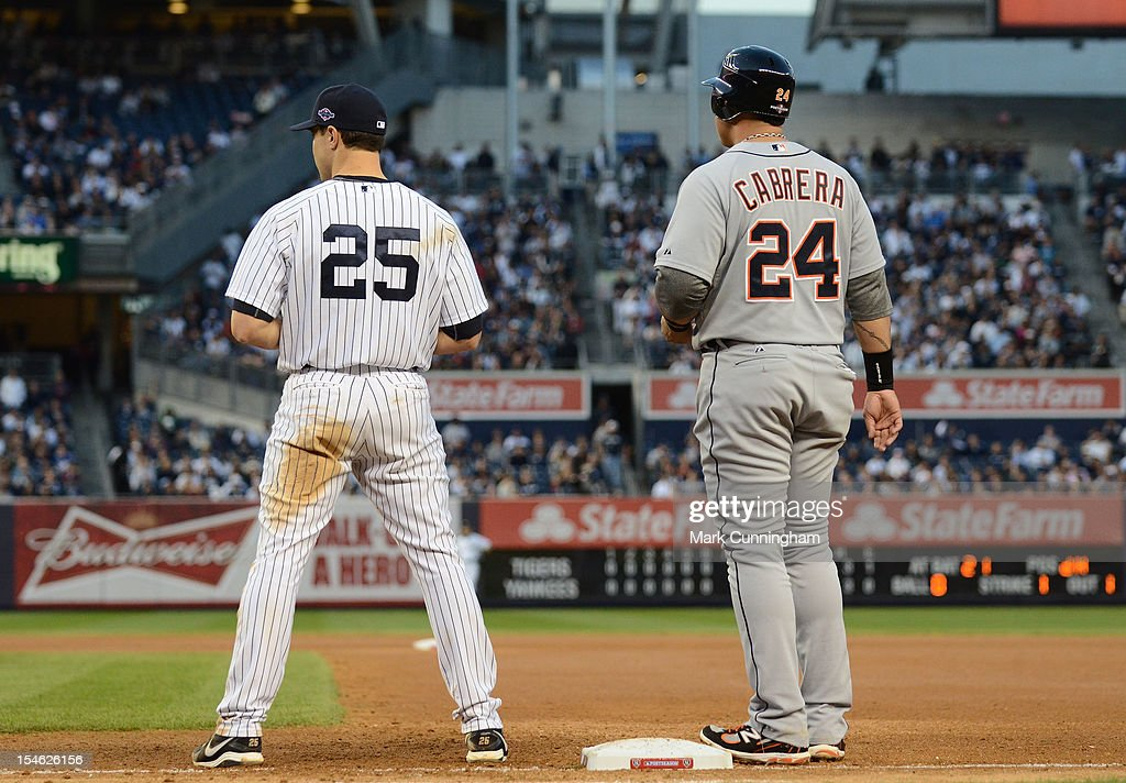 Miguel Cabrera #24 of the Detroit Tigers and Mark Teixeira #25 of the New York Yankees look on during Game Two of the American League Championship Series at Yankee Stadium on October 14, 2012 in the Bronx borough of New York City, New York. The Tigers defeated the Yankees 3-0.