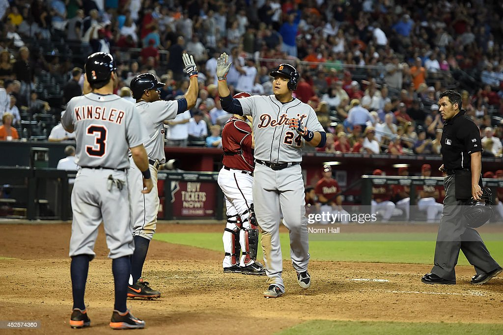 <a gi-track='captionPersonalityLinkClicked' href=/galleries/search?phrase=Miguel+Cabrera&family=editorial&specificpeople=202141 ng-click='$event.stopPropagation()'>Miguel Cabrera</a> #24 of the Detroit Tigers and teammates <a gi-track='captionPersonalityLinkClicked' href=/galleries/search?phrase=Rajai+Davis&family=editorial&specificpeople=810608 ng-click='$event.stopPropagation()'>Rajai Davis</a> #20 and <a gi-track='captionPersonalityLinkClicked' href=/galleries/search?phrase=Ian+Kinsler&family=editorial&specificpeople=538104 ng-click='$event.stopPropagation()'>Ian Kinsler</a> #3 celebrate a three-run home run during the eighth inning against the Arizona Diamondbacks at Chase Field on July 23, 2014 in Phoenix, Arizona.