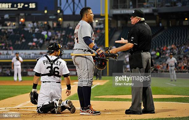 Miguel Cabrera of the Detroit Tigers argues with home plate umpire Brian Gorman after he was ejected as catcher Josh Phegley of the Chicago White Sox...
