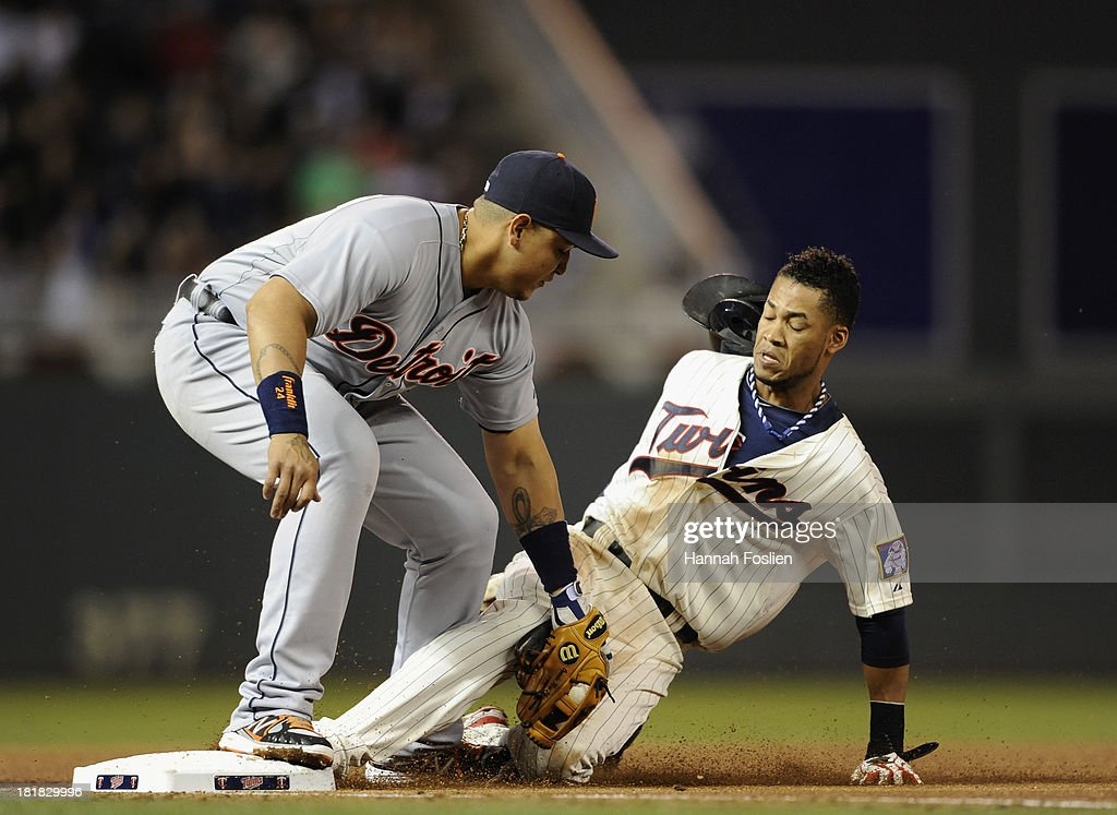Miguel Cabrera #24 of the Detroit Tigers catches Pedro Florimon #25 of the Minnesota Twins stealing third base during the fifth inning of the game on September 25, 2013 at Target Field in Minneapolis, Minnesota.