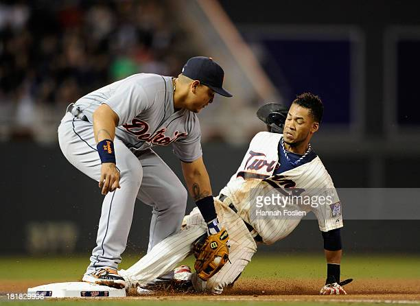 Miguel Cabrera of the Detroit Tigers catches Pedro Florimon of the Minnesota Twins stealing third base during the fifth inning of the game on...